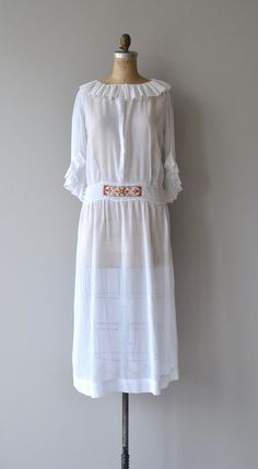 Antique 1920s semi-sheer white cotton batiste dress with ruffled collar and sleeves, tiny pintucks, drop waist, crochet side button detail, 3/4