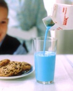 Adding food coloring to milk mkes it fun for kids and a tricky way to get them to drink it.