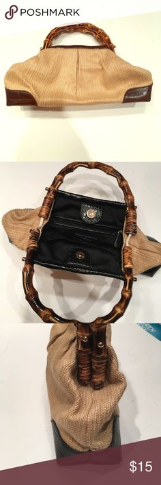 Rattan and bamboo handled Loft handbag Adorable beige, black and brown rattan bag by Ann Taylor Loft. Nice size to hold your necessities. Hinged bamboo handles with glossy brown finish. Perfect for spring! LOFT Bags Clutches & Wristlets