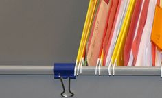 Use binder clips to keep hanging files from sliding. Very smart!