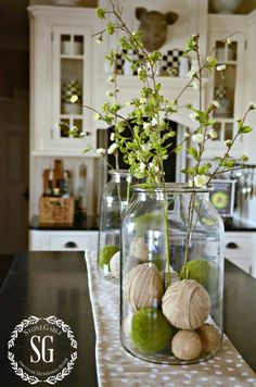 SPRING ISLAND JAR VIGNETTE- two big jars with burlap and moss balls at bottom You can find similar great projects and ideas as shown in the picture in our magazine. Spring Home Decor, Diy Home Decor, Spring Kitchen Decor, Rustic Decor, Farmhouse Decor, French Farmhouse, Country Farmhouse, French Country, Big Jar