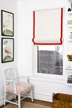 a simple white roman shade embellished with cherry tape- a great subtle way to add that pop of color!  from littlegreennotebook.blogspot.com