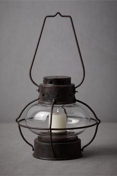 If it's in the budget I would LOVE to have a few of these to decorate with, and then I could use them to decorate our home :) { Twilit Savanna Lantern, from BHLDN [$28] }