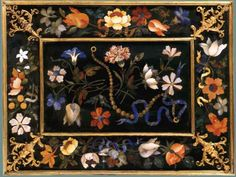 Pietre Dure or hard stone mosaic was a costly and time-intensive art form perfected during the renaissance in Florence under the patronage of the Grand Dukes of Tuscany, the Medici. Its realistic flowers and string of pearls are made of natural precious and semi-precious stones such as carnelian, lapis lazuli and mother of pearl.