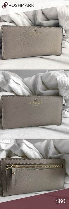 Kate Spade 'Stacy' wallet ♠️ Never use this anymore and need to get rid of it! It's been worn a little bit, so it's not in brand new condition. BUT it's still in great condition! If you have any concerns, just leave me a comment! :) kate spade Bags Wallets