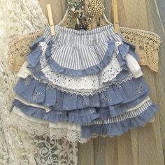 """Girl's Ruffled Skirt With """"Bustle"""" Back Custom Made Front Featuring light weight, cotton, blue and white stripe """"mattress ticking"""", a denim blue soft cotton eyelet material, matching denim blue cotton (not denim), and white eyelets laces and cottons."""