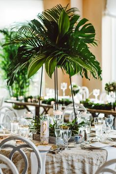 Tropical wedding reception, palm fronds, candles, table design, gold-rimmed glasses, natural centerpieces // Aster + Olive Photography