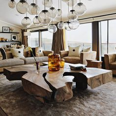 Love the multiple light fixtures at various heights and the ginormous coffee table......Kelly Hoppen |Pinned from PinTo for iPad|