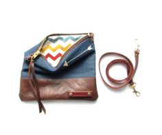 Arrows cross body bag // denim and leather pouch // denim and leather crossbody bag // fold over clutch on Etsy, $65.49