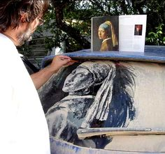 """Dirty car art, in Austin TX. This guy wanders around parking lots and finds the dirtiest rear windshields he can, then """"paints"""" art into them by selectively removing some of the dirt. SOOOO BEAUTIFUL!!"""