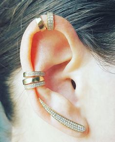 Fierce Ear Game!  14K Gold and Diamond Ear cuffs surround this stunning Diamond Blade Climber from the Ear Stylist by Jo Nayor.  Pin This and check it out at www.earstylist.com