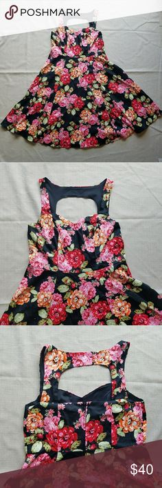 Torrid Floral Cotton Sateen Swing Dress Size 12 Torrid Floral Cotton Sateen Swing Dress Size 12, super cute and stretchy (could fit a 14) with an adorable open back. Perfect for a date night or even a wedding! Worn once. Sold out online. torrid Dresses Midi