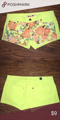 Bright shorts Bright yellow shorts with flower pattern on front! Size 7. Never been worn!! Get them before their gone!! Shorts Cargos