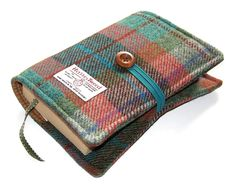 This padded book cover Autumn Days has been hand made using Harris Tweed, handwoven on the Isle of Harris in the Outer Hebrides. SIZE: Suitable for a small to medium paperback or hardback books measuring (when closed) approximately: 8.25 inch high (20.5 cm) 5.5 inch wide (14 cm) Up to 1.75 inch thick (4.5 cm) If you require a larger size then please use this link: https://www.etsy.com/listing/177175853/harris-tweed-large-bible-cover-6-fabric If you would like a smalle...