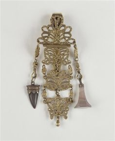 "Chatelaine belonging to Empress Josephine, probably French, c. 1790's. A chatelaine was worn at the waist, often carrying small sewing tools, watches, and other objects, suspended from chains. In the 18th century they were commonly referred to as ""equipage"", along with numerous other types of accessories or equipment."