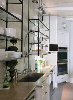 iCreative Tonic loves kitchen shelves + kitchen inspiration - Love the aged metal and glass shelves, white cabinets, and white dinnerware in this vintage modern kitchen design. Glass Shelves Kitchen, Glass Kitchen, New Kitchen, Kitchen Black, Kitchen Backsplash, Kitchen Bookshelf, Metal Kitchen Cabinets, Glass Wall Shelves, Room Shelves