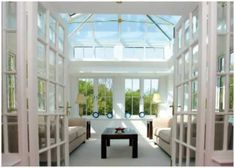 Orangeries and Orangery styles and designs in timber, aluminium and Upvc with unique painted finishes What Is An Orangery, Glass Room, Slate Flooring, Conservatories, Folding Doors, New Living Room, Large Windows, Interior Walls, Glass Design