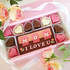 Delicious Mother's Day chocolates. Say how much you love Mom with these beautiful pink and peach decorated chocolates. This unique gift of decadent chocolates, is presented in a white gift box and tied with a pink bow.  By Diamond Chocolates