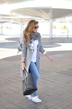 Fall / Winter - street chic style - comfy style - light grey plaid scarf + white shirt + light denim skinnies + white sneakers + grey textured long coat + black handbag + black sunglasses