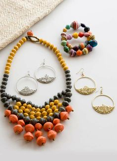 Incredible metallic & #paperbead pieces to punch up your daily wardrobe this spring in #fairtrade style.