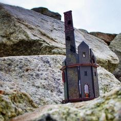 left sheltering under a rock on the beach at #mawganporth with 'all cornwall thundering at it's tiny door' for #freeartfriday, 03/02/2017. #fafnqy #lasercut #enginehouse #candle #charlescausley 🌬🌊🌧🌧