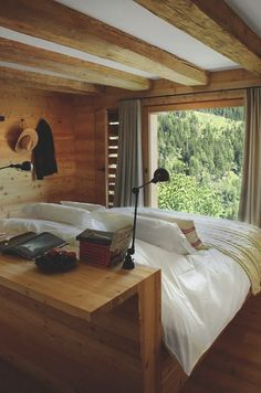 The guest rooms of Montagne Alternative in Switzerland have beds with a headboard/console table in the middle of the room facing a view of the Alpsgood Home Bedroom, Bedroom Decor, Wooden Bedroom, Master Bedroom, Bedroom Setup, Ikea Bedroom, Bedroom Furniture, Bedroom Ideas, Home Interior Design