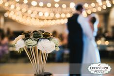 Bartz Viviano wedding flowers at Maumee Bay reception - Photos by Luckybird Photography