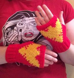 Inspired by Jean Grey turned Dark Phoenix these gloves sport a bright golden yellow Phoenix bird on a red background.  These gloves are not only awesome looking, but useful, as you can still craft, pa