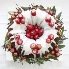 I made this cake for my Dad's birthday which happens to fall on Christmas Day itself. The cake was Baileys Irish Cream chocolate bundt cake, topped with peppermint white chocolate ganache, decorated with fresh raspberries, roasted walnuts, sage...