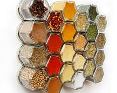 **PLEASE NOTE: Small Jars are back-ordered until Feb 1st.** *********************************************** Standard Spice Kit Includes: -:- 24 small (1.5 oz) hexagon magnetic jars for your fridge -:- Filled with ORGANIC spices -:- Hand-stamped lids, labeled with spice names -:- Internal food-safe magnet cap keeps spices and magnets separate ************************************************ Spices out of reach? Our magnetic spice jars are made to hold to your fridge. With spices in sight…