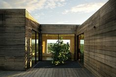 Timber clad building with courtyard