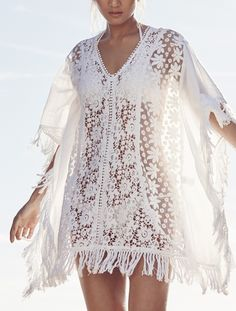 Sheer crocheted and floral lace panels enhance the free-spririted vibe of this flowy cover-up finished in tonal embroidery and fringe at the hems.