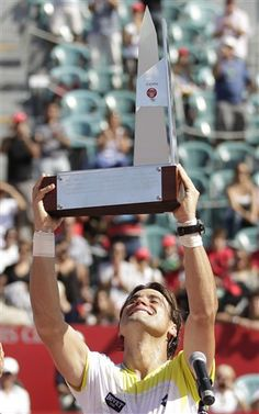 Spain's David Ferrer holds up the Claro Cup trophy after defeating Stanislas Wawrinka of Switzerland at end of the tournament tennis final in Buenos Aires, Argentina, Sunday, Feb. 24, 2013. Ferrer won 6-4, 3-6, 6-1. (AP Photo/Victor R. Caivano)