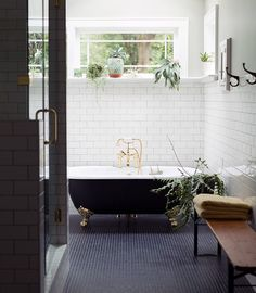 Bathroom. Open space. Big window. Subway + mini tile. Sitting bench. Dark floor + white walls.