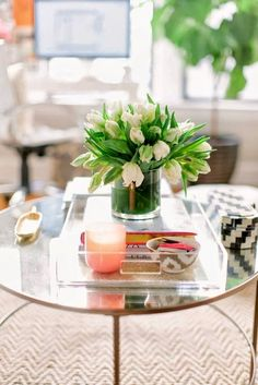 Transitional living room coffee table with #lucite tray and white #tulips. Love this fresh look for the #home!