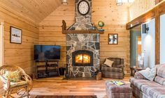 Cozy living room with a rustic stone fireplace as the centerpoint for the room