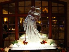 Turning Stone Ice Sculpture - Bride and Groom