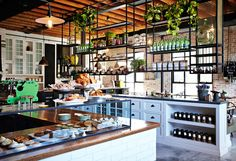The shaker style cabinets and metal rails that are basically a dream kitchen at The Grounds of Alexandria in Sydney. 31 Coffeeshops And Cafés You Wish You Lived In Cafe Bar, Cafe Restaurant, Restaurant Design, Organic Restaurant, Restaurant Interiors, Coffee Shop Design, Cafe Design, The Grounds Of Alexandria, Alexandria Sydney