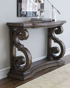 """Handcrafted of mindi wood with a mahogany finish and antiqued nailhead trim. 56""""W x 18""""D x 36""""T. Imported."""