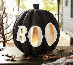 I love this boo pumpkin!! Cut out the interior of the letters to allow the candlelight to shine through.