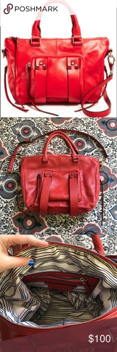 ❤️SALE Red leather She+Lo bag❤️ Gorgeous authentic red leather She+Lo bag! This was only used a few times and I got many compliments on it. Just like a little smaller purse now. Excellent condition, a little stained on the inside by the zipper but it may come out. It isn't noticeable and doesn't affect the beauty of this purse. It's roughly 16.5 inches wide and 11 inches long. She+lo Bags