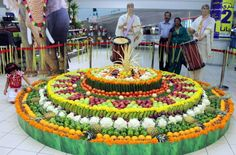 """A gaint """"Pookkalam"""" (floral decoration for Onam, the harvest festival of Kerala) made by fresh fruits and vegitables at Lulu hypermarket Al Wahda mall in Abu Dhabi."""