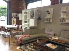 BoConcept Indivi sofa, functional coffee table, expanding dining table, and Mariposa Deluxe dining chairs