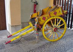 Sicily- I have a photo of this. This cart was used to carry the King at some point. (must've been a small dude)