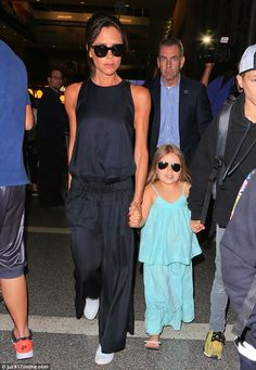 Cool ladies! Harper Beckham rocked a similar style to her mum Victoria on Sunday as the Be...