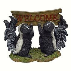 Something is in the Air Skunk Welcome Statue.  Welcome your guests with these (usually) pungent pets! Amazingly well sculpted, then cast in quality designer resin and hand-painted to capture their characteristic white striped fluffy tails, but not the stinky smell! #skunks #welcome #gardenstatue