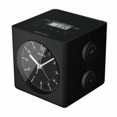 """Seiko """"Techni"""" cube alarm clock. Digital & analog with global AM/FM radio (we still use a clock radio at home!) This thing has all kinds of cool functions."""