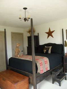 Liking the black coverlet and the antique one at the bottom of the bed. could do guest room like this. #PrimitiveBedroom
