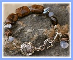 RainDancer -Bronzite -Holley Blue Chalcedony -Iced Blue Freshwater Pearls -Carved Mother-of-Pearl (Brown) -Sterling Silver Hook-Style Clasp  ::bracelet measures........7.5 inches