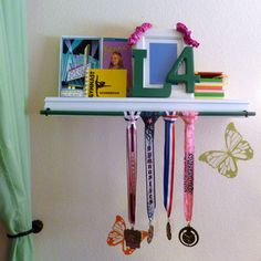DIY a simple Level 4 Gymnastics metal and trophy display.